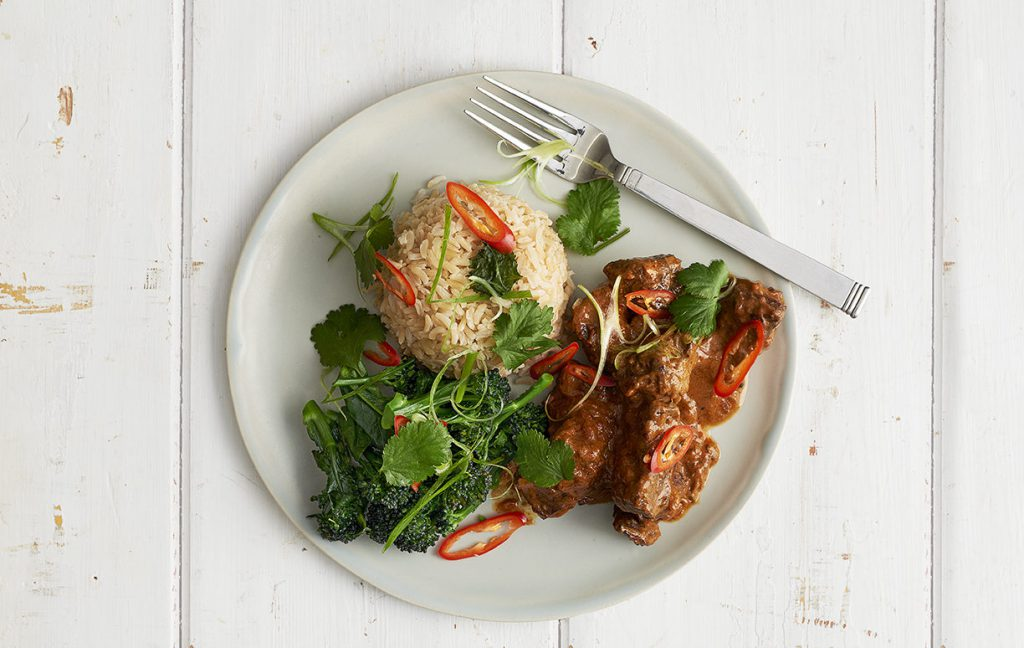 Thai red curry served with brown rice and fresh chilli