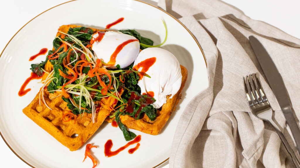 Savoury corn waffles with poached eggs